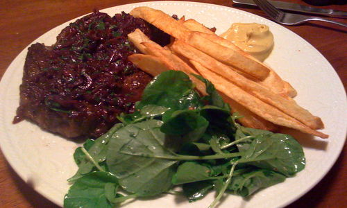 Steak, Fries, and a watercress salad